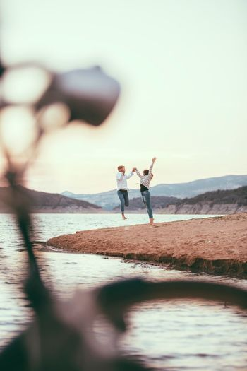 Happiness Full Length Two People Beach Sea Water Vacations Young Adult Nature Young Women Day Friendship Sky