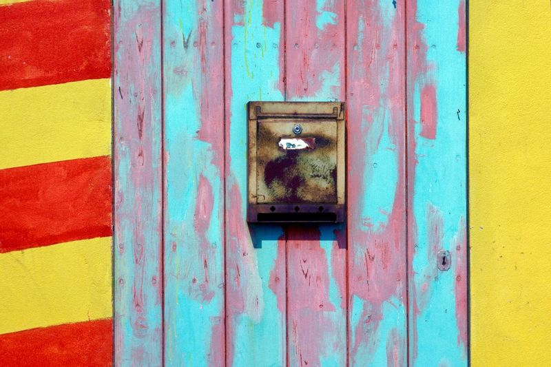 Architecture Blue Building Exterior Built Structure Close-up Day Door Entrance Mailbox Metal No People Old Outdoors Protection Red Safety Security Wall - Building Feature Weathered Wood - Material Yellow