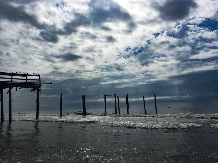 Remnants of the pier from Hurricane Matthew. Sea Water Sky Beach Horizon Over Water Nature Cloud - Sky Tranquility Beauty In Nature Scenics No People Tranquil Scene Sand Outdoors Day Pier