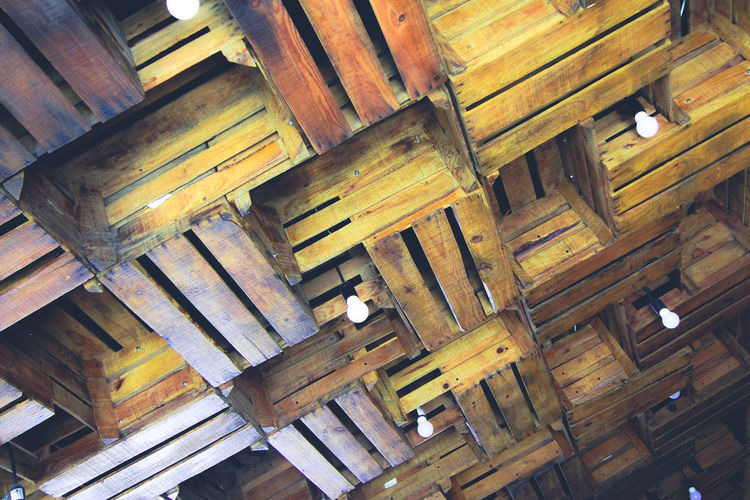 Low angle view of roof made with wood boxes