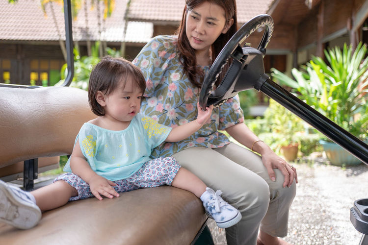 Bonding Casual Clothing Child Childhood Daughter Day Family Family With One Child Females Girls Innocence Leisure Activity Lifestyles Parent Positive Emotion Real People Sitting Three Quarter Length Togetherness Women