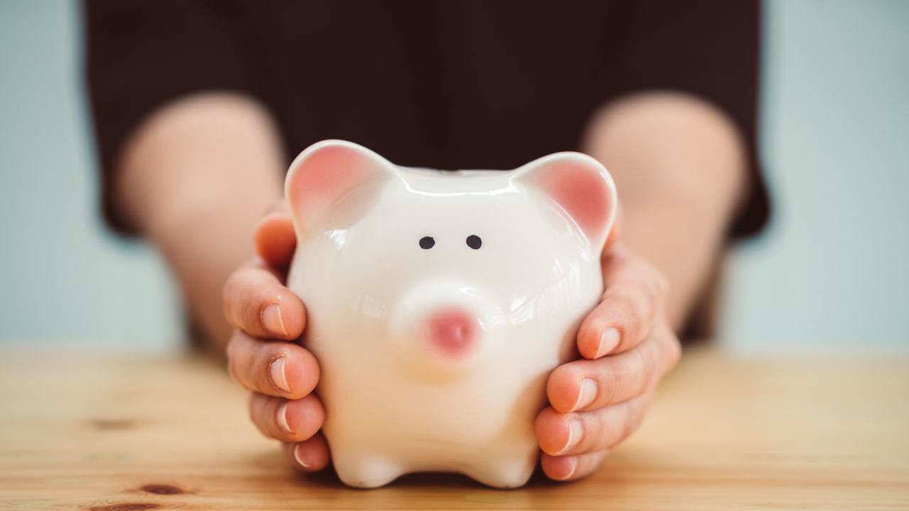 Close-up of woman holding piggy bank