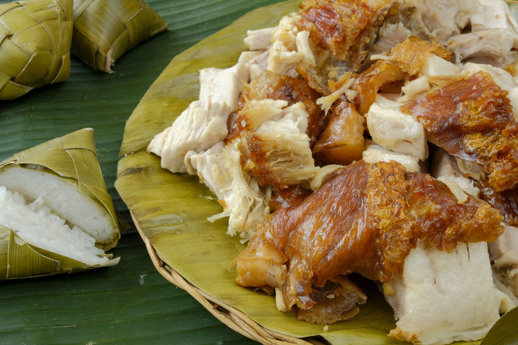Food And Drink Food Freshness Still Life Plate Ready-to-eat Meat Indoors  Close-up No People Banana Leaf High Angle View Serving Size Table Healthy Eating Wellbeing Leaves Meal Rice - Food Staple Vegetable Snack Pork Lechon