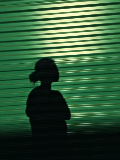 Silhouette One Person Real People Shadow Corrugated Pattern Corrugated Iron Standing Backgrounds Night Outdoors People Adult