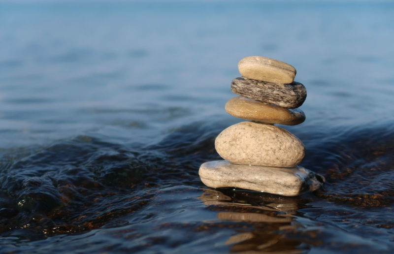 Stone balancing Life Liquid Meditation Yoga Balance Buddhism Close-up Concept Nature No People Outdoors Pebble Relaxation Rock Rock - Object Sea Solid Stack Stacked Stone Stone - Object Tranquility Water Zen Zen-like