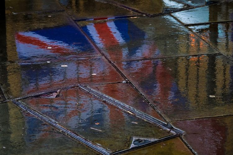 Union Jack Flag Reflection During Anti-Brexit Protests Outside Parliament Union Jack Flag Brexit Reflection Wet Water No People High Angle View Rain Day Puddle Road Outdoors Rainy Season City Backgrounds Full Frame Close-up