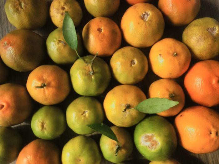 Full frame shot of oranges on table