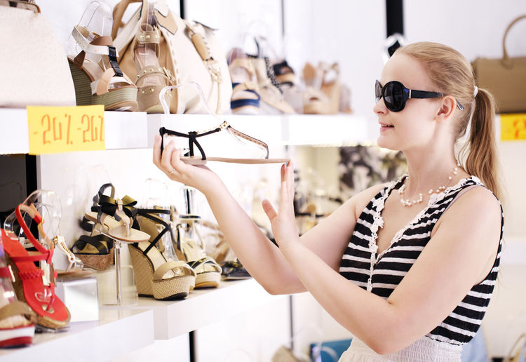 Assortment Caucasian Choice Choose Fashion Female Girl Peep-toes Person Purchase Sale Sandals Shop Shopping Store Summer Sunglasses Woman Young