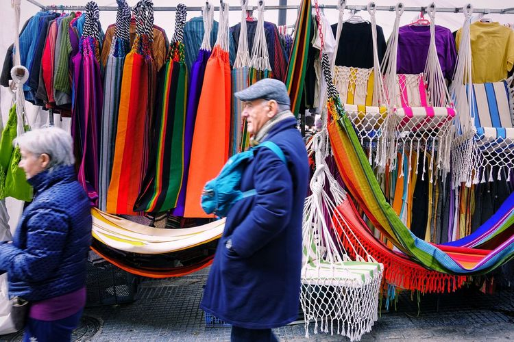 Choice Retail  Adult One Person Men Standing Multi Colored Variation Small Business Store Senior Adult Business Market Three Quarter Length Sale Mature Men Large Group Of Objects Hanging Madrid SPAIN