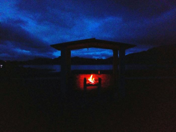 The only ligth Laguna Agua Naturaleza Lago Tranquilidad Peace Nubes Blue Blue Sky Fuego Manto The Photojournalist - 2018 EyeEm Awards Illuminated Sky Architecture Bonfire Tea Light Flame Fire Campfire Burning Fire - Natural Phenomenon