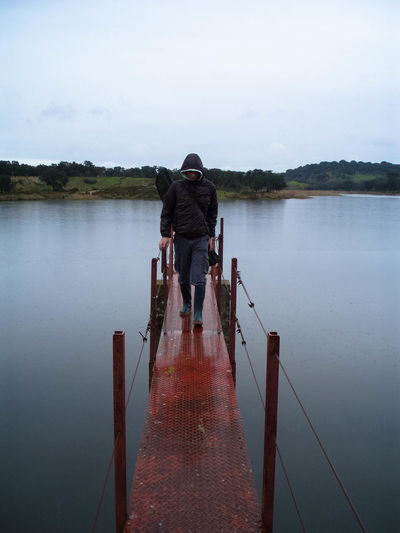 GoneFishing Beauty In Nature Calm Casual Clothing Day Fisherman Fishing Full Length Idyllic Jetty Lake Leisure Activity Lifestyles Nature Outdoors Pier River Scenics Sky Standing The Way Forward Tourism Tranquil Scene Tranquility Water . . People And Places