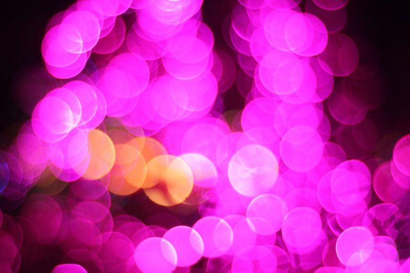 Bokeh light effect of purple and yellow lights Seasonal Christmas Bokeh Defocused Pink Color Night Illuminated No People Backgrounds Glowing Lighting Equipment Celebration Abstract Pattern Purple Multi Colored Light Geometric Shape Light Effect Decoration Vibrant Color Electric Light