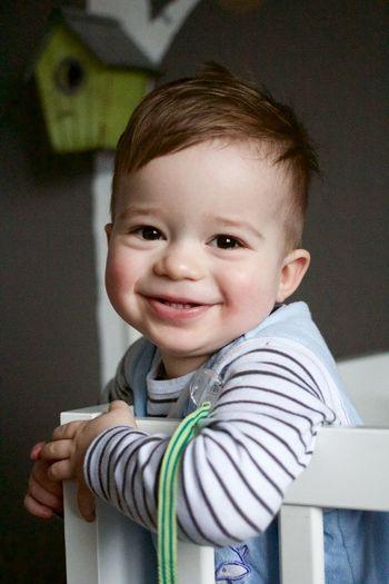 Close-Up Portrait Of Cute Boy In Crib