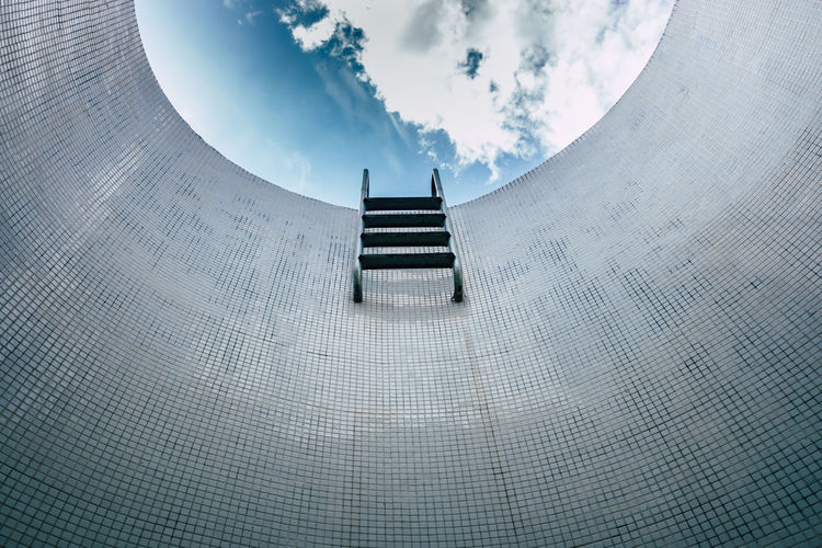 Digital composite image of staircase and building against sky