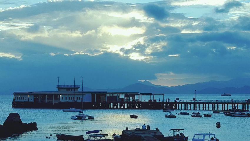 A scene at Lamma Island, Hong Kong. Hong Kong Lamma Island Sun Rays Sky Sea Pier