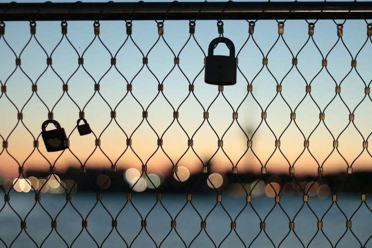 Architecture Chainlink Fence Clear Sky Close-up Day Focus On Foreground Hanging Hope Luck Metal Nature No People Outdoors Protection Safety Sky Water