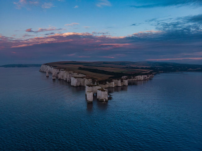 An Old Sunrise Drone  Aerial View Architecture Beauty In Nature Built Structure Cloud - Sky Drone Photography Horizon Horizon Over Water Idyllic Nature No People Non-urban Scene Old Harry Rocks Outdoors Scenics - Nature Sea Sky Sunset Tranquil Scene Tranquility Water Waterfront The Great Outdoors - 2018 EyeEm Awards