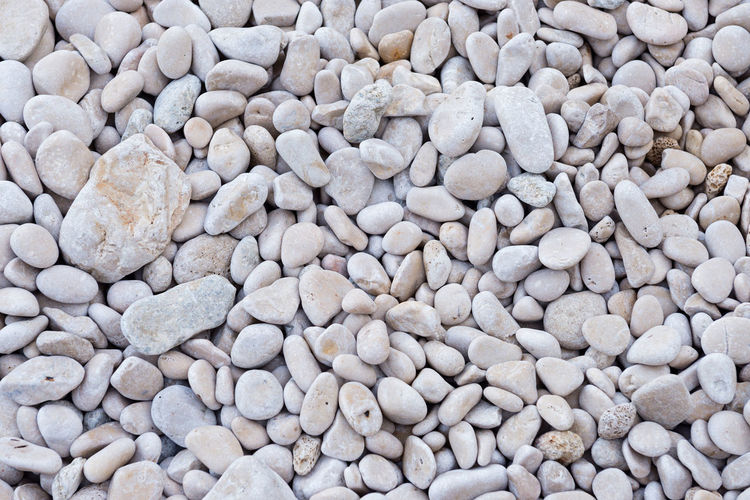 Background from gray sea stones for design Abundance Backgrounds Beach Beauty In Nature Close-up Day Full Frame Large Group Of Objects Nature No People Outdoors Pebble Pebble Beach