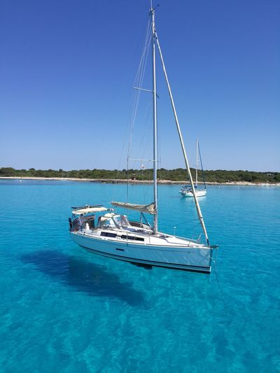 clear waters Yachting Sailing Ship Water Nautical Vessel Yacht Clear Sky Sailing Sea Mast Sailboat Boat Sailing Boat Horizon Over Water Tranquil Scene Calm Scenics Idyllic