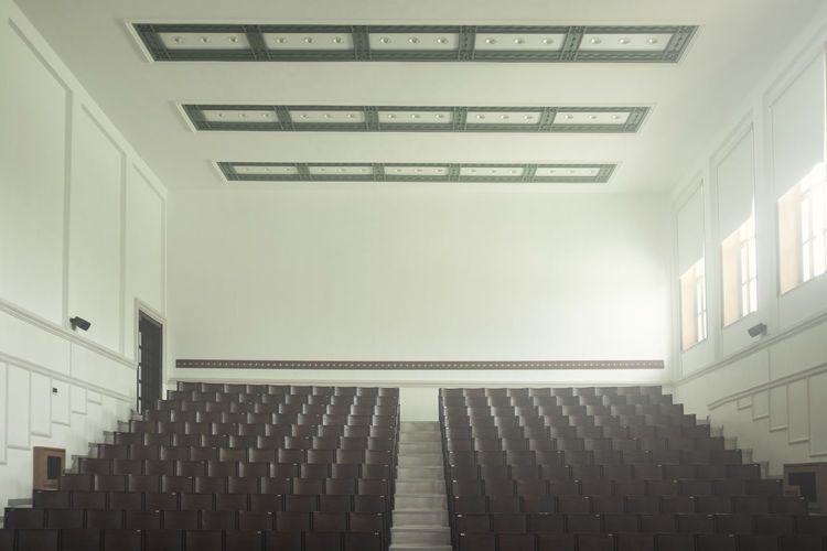 Architecture Indoors  Built Structure Building No People Wall - Building Feature Empty Absence Education School Modern White Color Low Angle View Seat Pattern Illuminated Window Architectural Feature Ceiling Staircase University Campus Natural Light