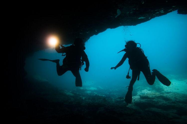 Scuba Divers In Sea
