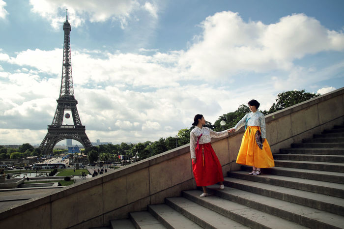 Architecture Asian  Built Structure Capital Cities  Casual Clothing City City Life Cloud Cloud - Sky Cloudy Day Friends Friendship Full Length Leisure Activity Lifestyles Low Angle View Outdoors Paris People Sky Stairs Tour Eiffel Tourism Travel Destinations