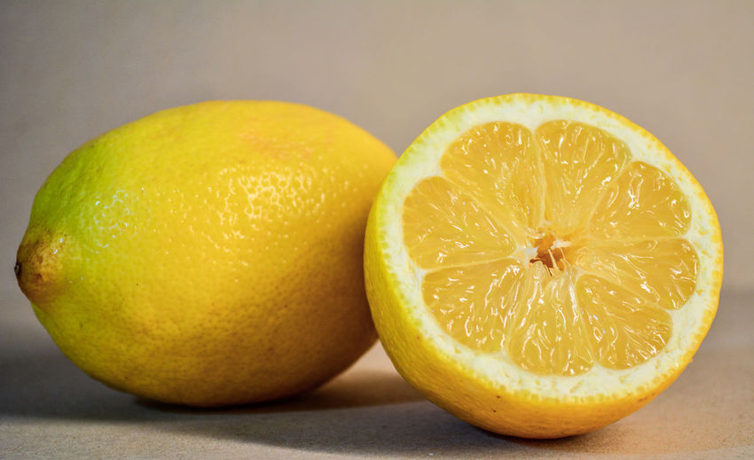 Fruit Healthy Eating Citrus Fruit Food And Drink Food Freshness Wellbeing Close-up Indoors  SLICE Yellow Lemon Cross Section Studio Shot No People Two Objects Halved Orange Color Still Life Juicy Orange Ripe Antioxidant Vitamin C Sour Taste