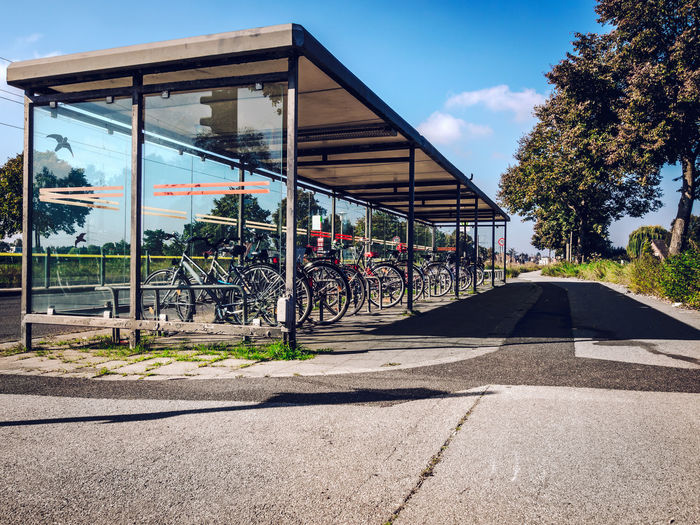 Bicycles Parked At Rack Against Sky