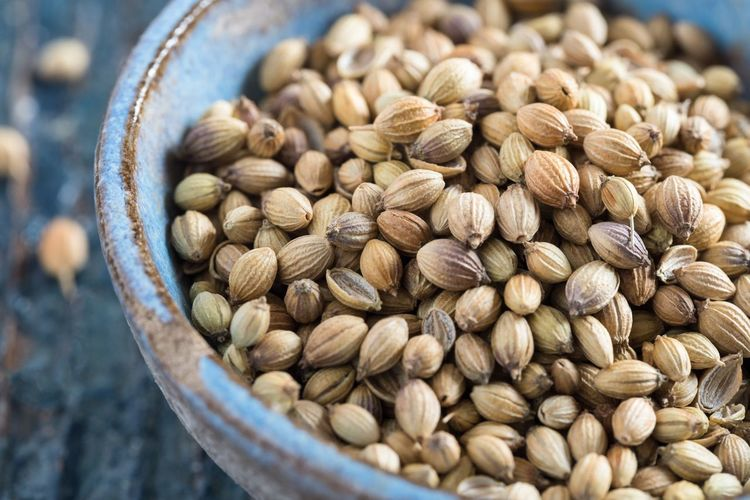 Close-up of coriander seeds in bowl on table