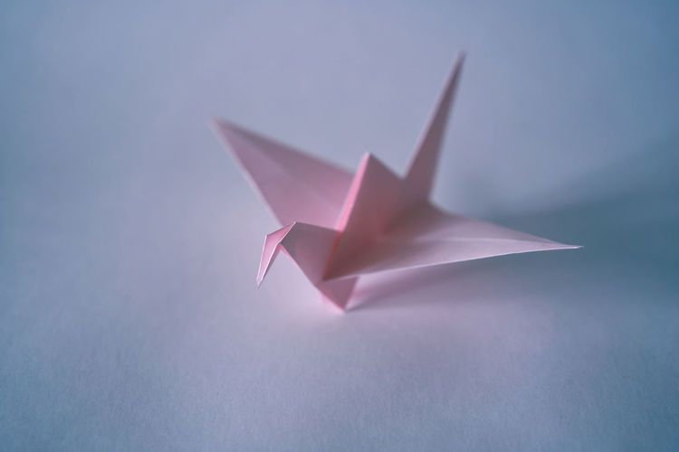 High angle view of paper toy against white background