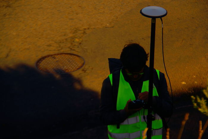 Adult Adults Only Enjoy The New Normal Lifestyles Light And Shadow Measurement Point Men Night One Man Only One Person Only Men Outdoors People Real People Reflection In Glasses Road Sewer Cover Surveyorjob Surveyors Equipment