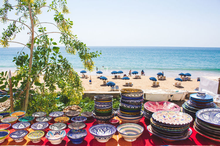 Morocco Souvenirs and Taghazout Beach Morocco Taghazout Beach Africa Beach Beauty In Nature Clear Sky Day Food Food And Drink Glass Horizon Horizon Over Water Land Nature No People Plant Scenics - Nature Sea Sky Table Taghazout Taghazout Surfing Tree Variation Water