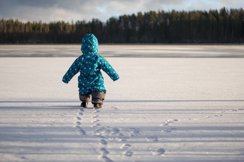 Boy going into the wild Lake EyeEm Selects Winter Snow Cold Temperature Child Childhood One Person Tree Land Day Walking Innocence Real People Nature Warm Clothing First Eyeem Photo