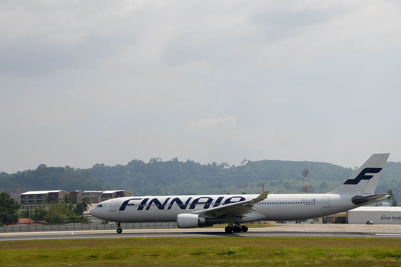 Airplane Airport Airport Runway Dark Day Finnair Landing No People Outdoors Phuket,Thailand Plane Runway Sky Sky And Clouds Transportation