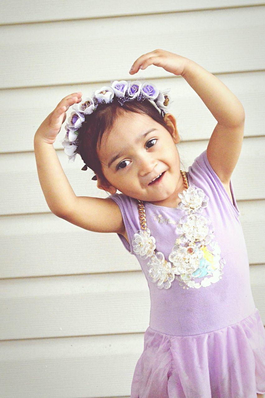 Cute Ballerina Dancing Against Home