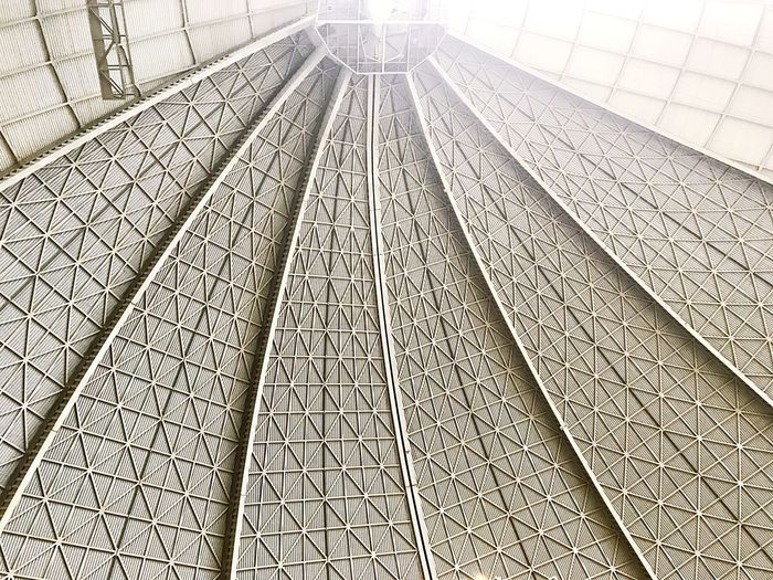 Sunlight through the hangar roof Structure Sunlight Doors Hangar EyeEm Selects No People Backgrounds Day Outdoors Architecture Colour Your Horizn