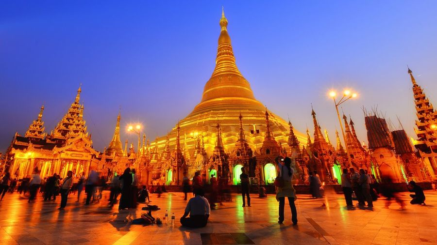 Worshipping Religious Architecture Religious  Worship Places Myanmar Religion Belief Architecture Sky Built Structure Building Exterior Spirituality Place Of Worship Illuminated Group Of People Travel Destinations Real People Pagoda Tourism