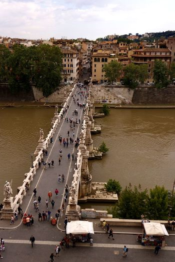 The busy Ponte Sant' Angelo in Rome Italy as viewed from the top of Castel Sant' Angelo Tourist Attraction  Travel Photography Architecture Bridge Bridge - Man Made Structure Building Exterior Built Structure City Crowd Day Group Of People High Angle View Historical Incidental People Nature Nautical Vessel Outdoors Pedestrian Bridge Real People River Tourist Destination Transportation Travel Travel Destination Water