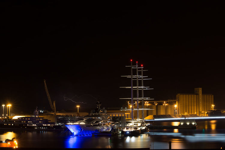 Night Illuminated Transportation Nautical Vessel Sky Water Waterfront Architecture Building Exterior Mode Of Transportation Built Structure No People Reflection Nature Copy Space Harbor Sea City Outdoors Sailboat Skyscraper Yacht Bolt Thunderstorm Thunder Yatch Ship