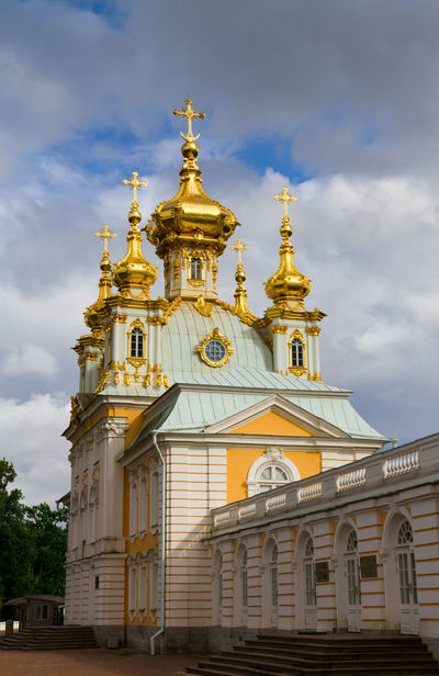Low angle view of Peterhof Palace / Saint Petersburg Gold Petergof Peterhof Russia Saint Petersburg Sankt-Petersburg Architecture Building Exterior Built Structure Cloud - Sky Day Dome Gold Colored Gold Plated History Low Angle View No People Ornate Outdoors Palace Peterhof Palace Place Of Worship Religion Sky Spirituality