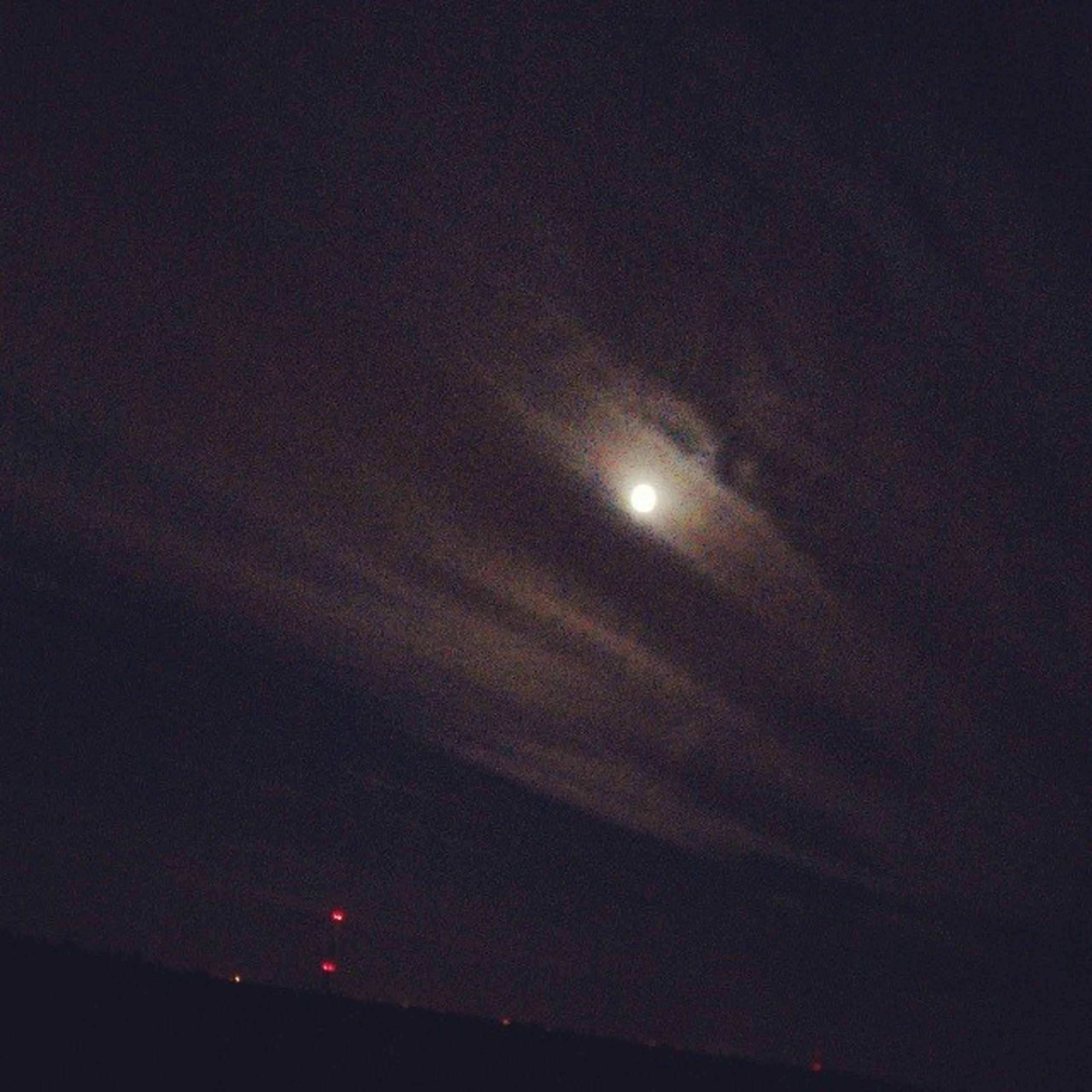 night, moon, low angle view, illuminated, sky, full moon, astronomy, dark, scenics, beauty in nature, nature, lighting equipment, tranquility, street light, copy space, moonlight, outdoors, no people, dusk, light - natural phenomenon