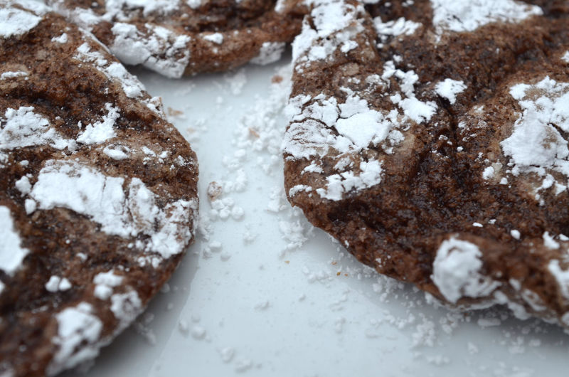 High Angle View Of Cookies With Powdered Sugar On Table