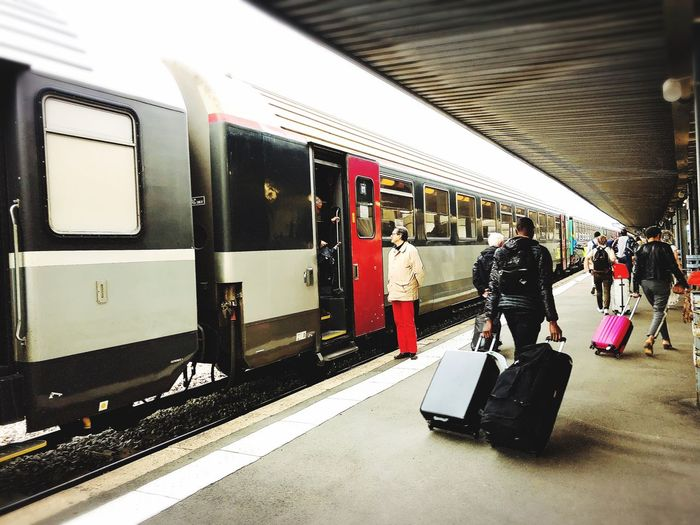 Station and Travelers Transportation Mode Of Transportation Public Transportation Rail Transportation Train Travel Train - Vehicle Railroad Station Platform People Passenger Commuter Day