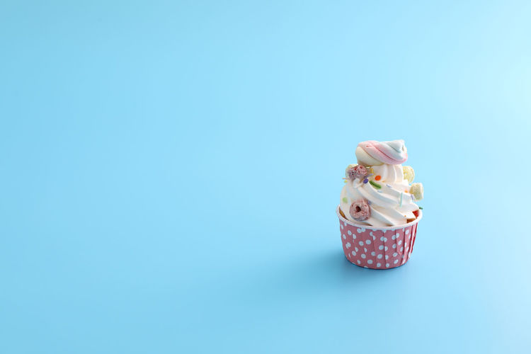 Close-up of cupcakes against blue background