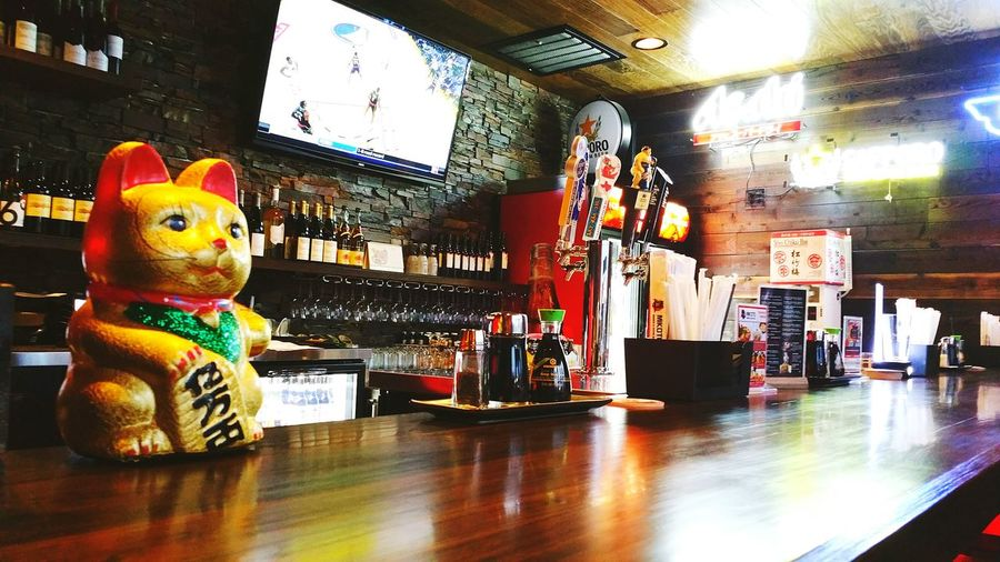 Over the counter... Bar Alcohol Japanese Beer Beverages Beer Spirits Liquour Sports Bar Ramen Lucky Charm Talisman Gold Maneki Neko Japanese  Japanese Lucky Charm Japanese Lucky Cat Lucky Cat Welcoming Cat Beckoning Cat Fortune Cat Over The Counter Counter Service Bar Bar Seating