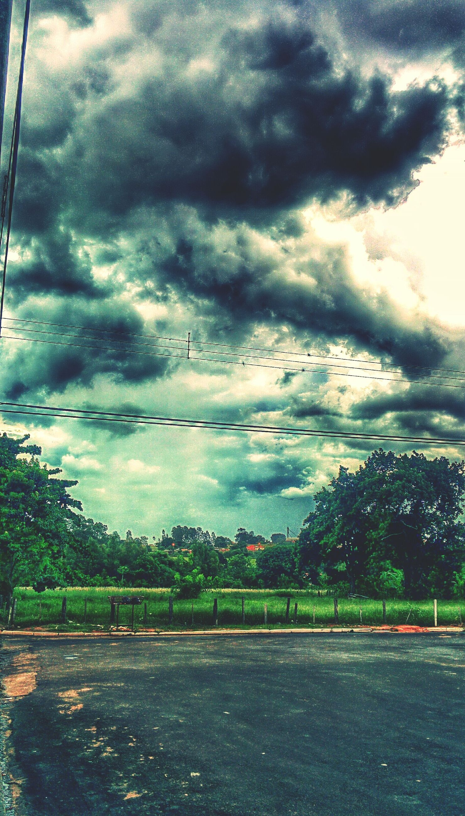 sky, cloud - sky, cloudy, weather, overcast, storm cloud, road, tranquil scene, tranquility, cloud, scenics, tree, landscape, nature, beauty in nature, field, dramatic sky, the way forward, transportation, street