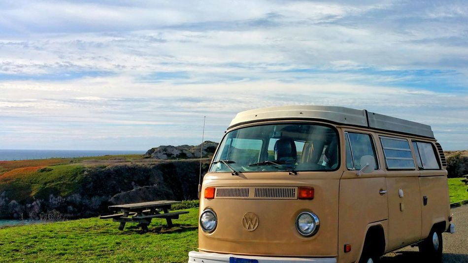 Now thats a classic. .. VW Volkswagen Bus Volkswagen Mode Of Transport Transportation Outdoors Cloud - Sky Copy Space Ocean Overlook Yellow Tan Classic Antique Old Van Old Awesome Vehicle Emblem  Backgrounds Zen Nirvana Road Memories Sign Be. Ready.