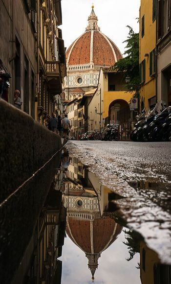 Duomo Santa Maria Del Fiore Reflecting In Puddle On Street