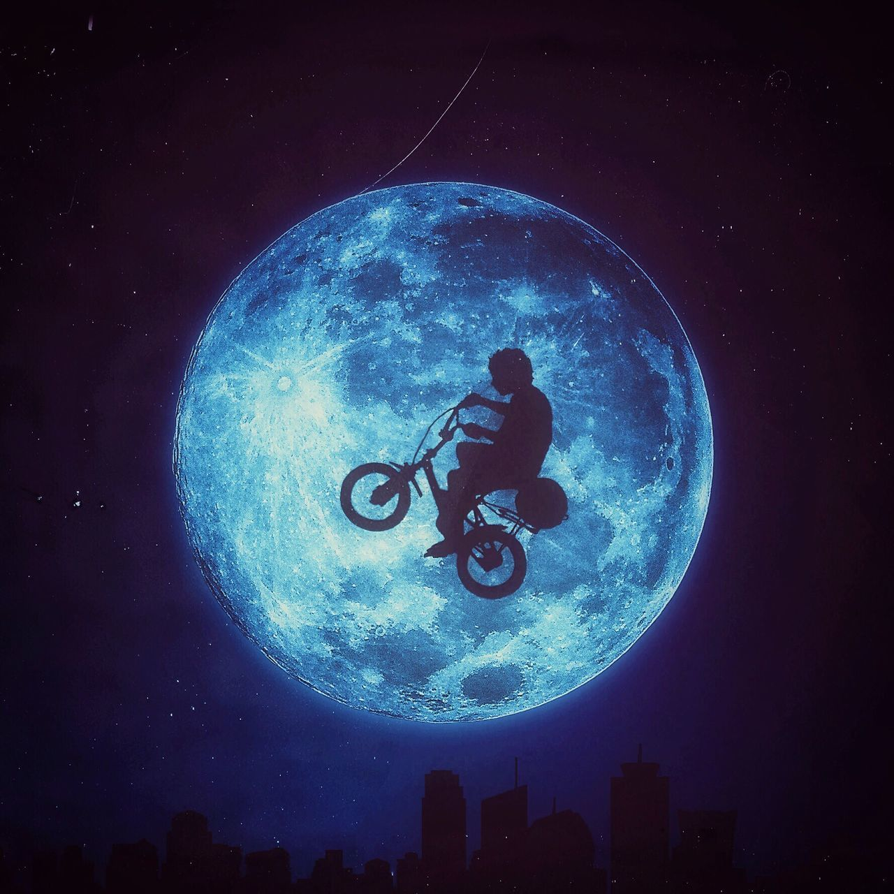 Digital composite of man stunt with bicycle