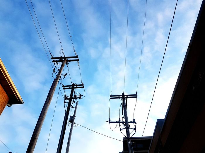 Connection Technology Electricity  Sky Connection Electricity Pylon Cloud - Sky Low Angle View Cable Nature Power Supply Fuel And Power Generation Power Line  No People Day Communication Exchanging Outdoors Built Structure Architecture Backgrounds Building Exterior Environment Pattern Poles Connection And Communication
